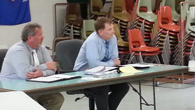 State Sen. Rick Gudex, left, and State Rep. Jeremy Thiesfeldt listen to constituent concerns at a listening session May 11 at the Town of Taycheedah Town Hall.