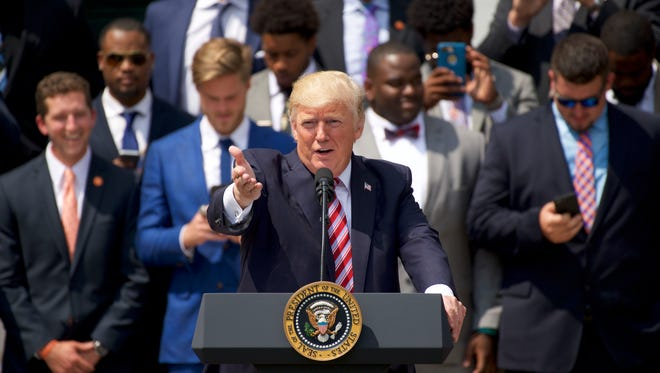 Jun 12, 2017; Washington, D.C., USA; United States President Donald Trump delivers remarks on the White House South Lawn to celebrate the Clemson Tigers 2016 NCAA Football National Championship.