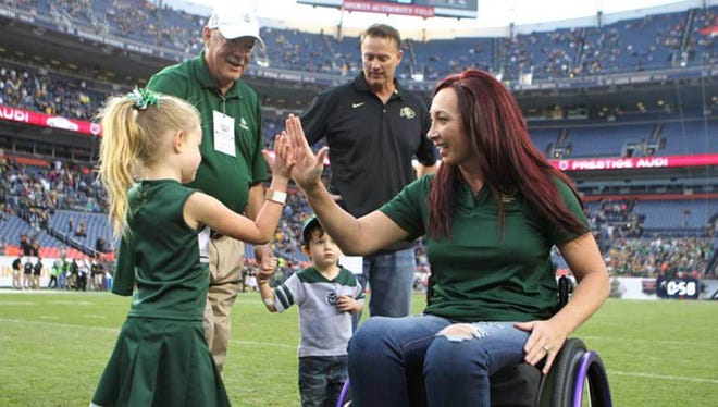 Amy Van Dyken, Olympic medalist and CSU swimming legend, was on the field at Sports Authority Field at Mile High for the Rocky Mountain Showdown this year, just months after a near-fatal ATV accident.
