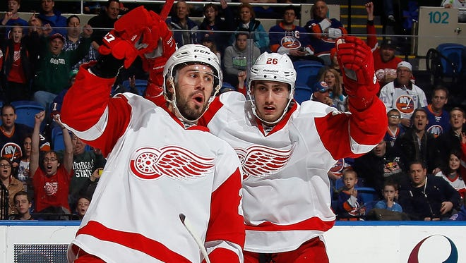 Drew Miller, left, and Tomas Jurco of the Detroit Red Wings celebrate a goal against the New York Islanders on March 29, 2015, in Uniondale, New York.