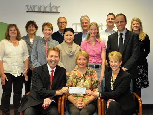 Federated Insurance Presents Check to BBBS Board Members.JPG