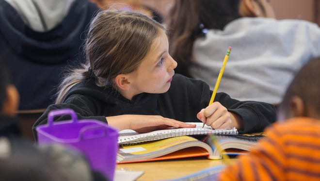 Sarah Salcido works on her lesson in Rosa Marquez's third-grade class at Kendrick Elementary School.