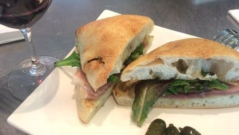 Ciabatta with prosciutto, fig jam, arugula and brie with a  glass of sangiovese at Vino Volo at Nashville International Airport.