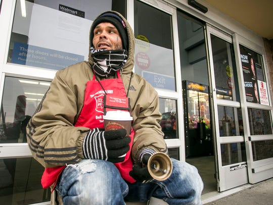 Volunteer Dominick Carter, of York City, holds a cup