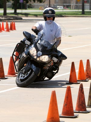 The Kawasaki motorcycles used by the Wichita Falls Police Department, seen here during training in 2014, are clearly marked as police units.