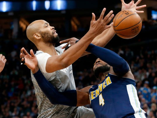 Minnesota Timberwolves' Taj Gibson, left, knocks the ball loose from Denver Nuggets' Paul Millsap during the second half of an NBA basketball game Wednesday, April 11, 2018, in Minneapolis. The Timberwolves won 112-106 in overtime. (AP Photo/Jim Mone)