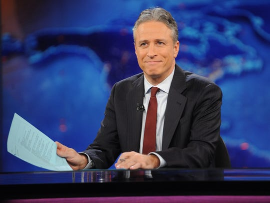 "This Nov. 30, 2011 file photo shows television host Jon Stewart during a taping of ""The Daily Show with Jon Stewart"" in New York."