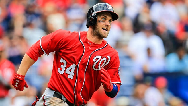 Washington Nationals left fielder Bryce Harper (34) runs to first on a double in the sixth inning against the Atlanta Braves.