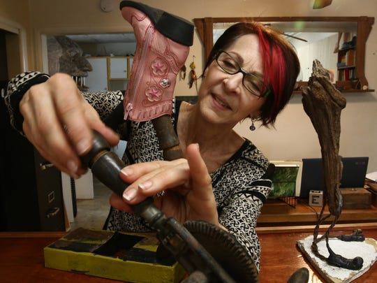 Suprina Troche adjusts a sculpture at her studio in the City of Poughkeepsie on Tuesday, March 20, 2018.