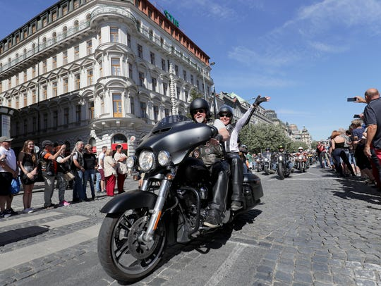 A rider waves to parade watchers in Wenceslas Square