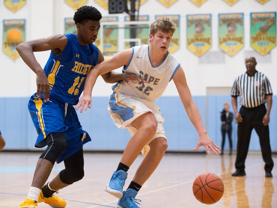 Caesar Rodney's Shaft Clark (15), left defends against Cape Henlopen's Ian Robertson (32) during their game at Cape Henlopen High School.