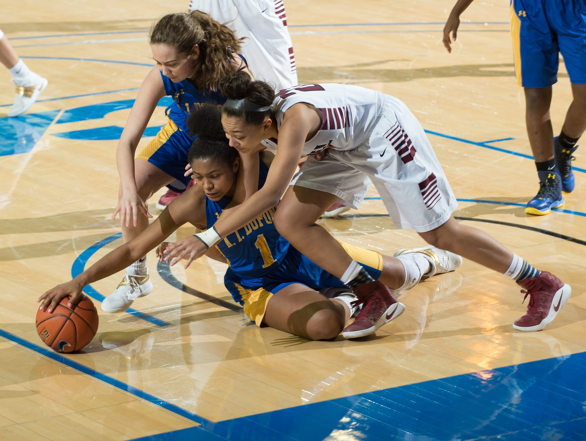 A.I. duPont's Alexandria Ferrell (1) gets her hand of a loose ball in the quarterfinals of DIAA Girls Basketball Tournament at the University of Delaware against Caravel.