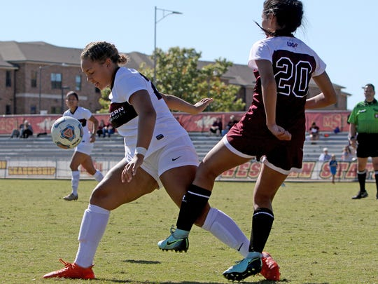 Midwestern State's Madison Williams works to keep the ball away from West Texas A&M's Jessica Diaz Sunday, Oct. 29, 2017, at Stang Park.