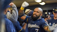 Brewers first baseman Eric Thames exchanges forearm