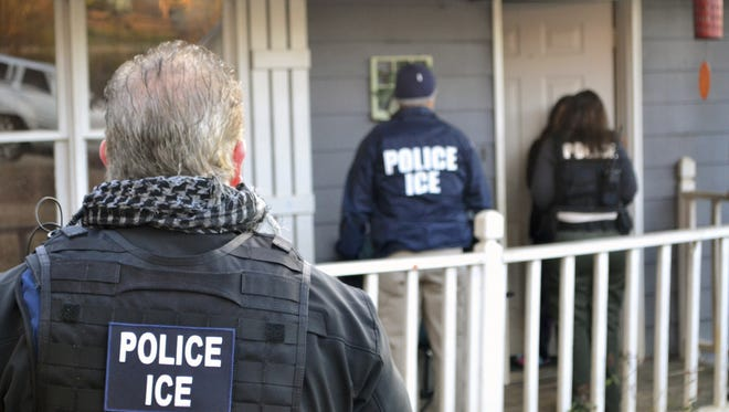 U.S. Immigration and Customs Enforcement agents work Feb. 9 at a home in Atlanta during an operation aimed at immigration fugitives, re-entrants and at-large criminal aliens. The Homeland Security Department said Feb. 13 that 680 people were arrested in roundups last week targeting immigrants living illegally in the United States.