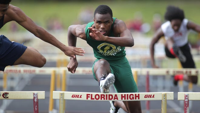 Lincoln's Vincent Johnson runs the 110-meter hurdles at the district meet. The FHSAA has moved to a two-day format for the state meet, separating prelims and finals into different days.