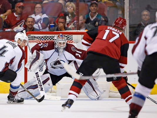 Arizona Coyotes right wing Radim Vrbata (17) gets set to fire off a shot for a goal against Colorado Avalanche goalie Calvin Pickard (31) as Avalanche's Tyson Barrie (4) and Mikhail Grigorenko (25) watch during the first period of an NHL hockey game Saturday, Oct. 29, 2016, in Glendale, Ariz. (AP Photo/Ross D. Franklin)