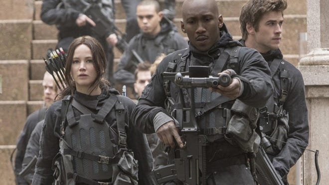 "Jennifer Lawrence, Mahershala Ali and Liam Hemsworth in ""The Hunger Games: Mockingjay — Part 2."""