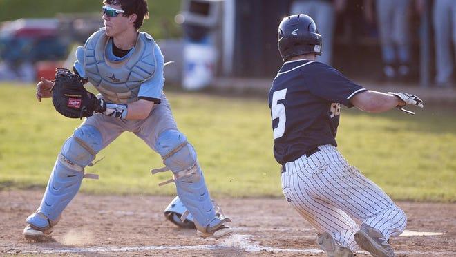 Burlington's Chris Fenimore (5) slides into home in the bottom of the seventh inning to beat South Burlington 4-3 in high school baseball on Thursday at Orrie Jay Field.