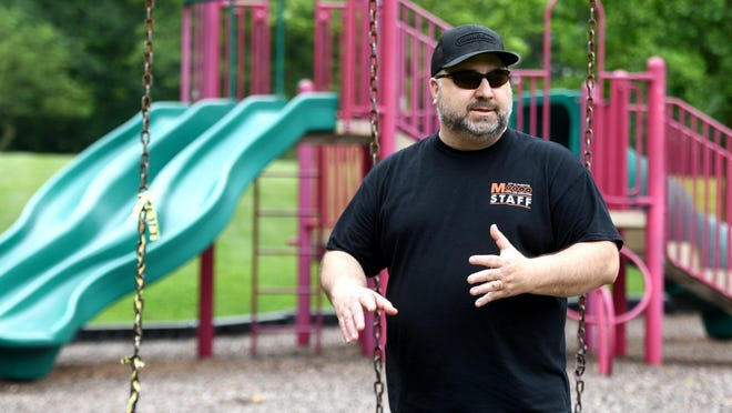 Massillon Parks and Rec Director Steve Pedro talks about preparing to open city playgrounds at Kiwanis Park in Massillon. The park has been closed since March. Gov. Mike DeWine announced this week that outdoor playgrounds could reopen June 10.