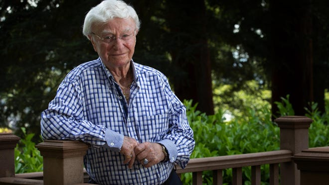 Henry Friedman stands on the deck behind his Mercer Island home Thursday, August 20, 2020. Friedman survived the Holocaust by hiding in an attic with his family. He came to Seattle, joined the Army and ran a successful jewelry business. He is hopeful, even now.
