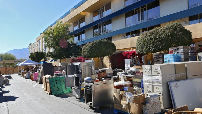 """The Spa Hotel is holding a """"garage sale"""" to liquidate the furnishings, beds, tv's and thousands of other items before the hotel is razed, Tuesday, November 25, 2014."""