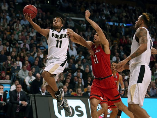 Purdue's P.J. Thompson, left, drives to the basket against Texas Tech's Zach Smith during the first half of an NCAA men's college basketball tournament regional semifinal Friday, March 23, 2018, in Boston. (AP Photo/Mary Schwalm)
