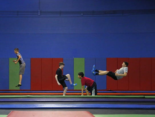 Children jump on the main court at AZ Air Time Indoor