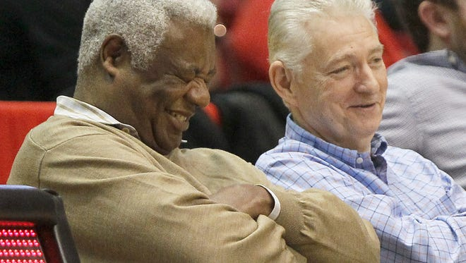 Former UC great Oscar Robertson (left) laughs with a friend during a Jan. 2 game between the Bearcats and Tulsa.