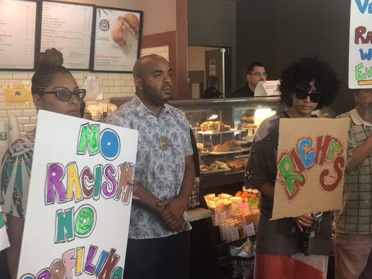 The small group of protesters blocks the counter at