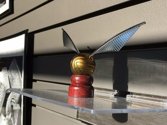 A golden snitch is on display at Pitman Gallery and