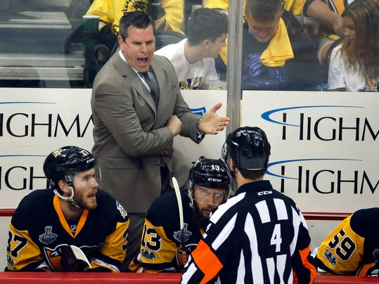 Pittsburgh Penguins head coach Mike Sullivan, left, appeals to referee Wes McCauley during the first period in Game 1 of the NHL hockey Stanley Cup Final against the Nashville Predators, Monday, May 29, 2017, in Pittsburgh. (AP Photo/Gene J. Puskar)
