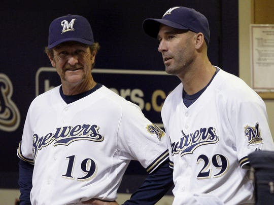 In this Sept. 26, 2008 photo, Milwaukee Brewers manager Dale Sveum, right, and bench coach Robin Yount talk during the first inning of a baseball game against the Chicago Cubs in Milwaukee. Philadelphia Phillies' four-game sweep of the visiting Brewers in mid-September ended Ned Yost's tenure as Milwaukee manager. Yost was fired Sept. 15 and replaced by his former third base coach, Dale Sveum. (AP Photo/Morry Gash)