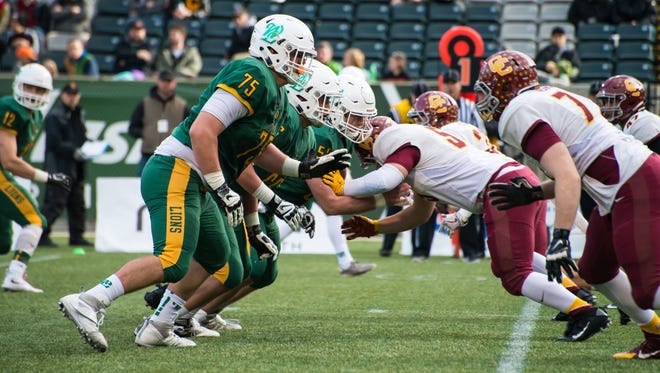 West Linn's Alex Forsyth (75) competes against Central Catholic in the state championship game.