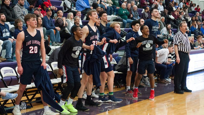 The East Lansing bench celebrates as their team gets ready to win their regional semifinal against Kalamazoo Central on March 12, 2018, at Lakeview High School.