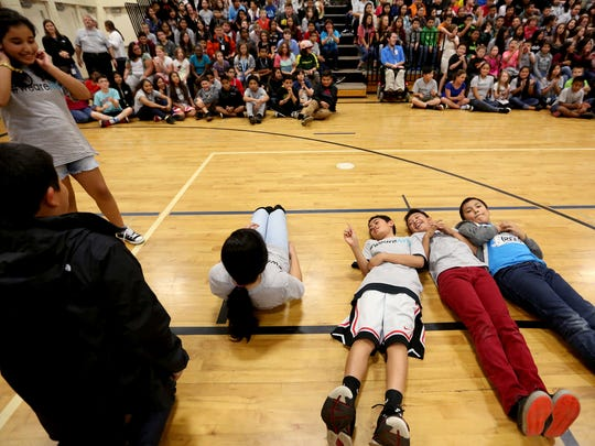 Sixth-graders play a game during an assembly announcing the start of an effort to earn the status of an AVID National Demonstration School at Stephens Middle School in Salem on Wednesday, Oct. 14, 2015.
