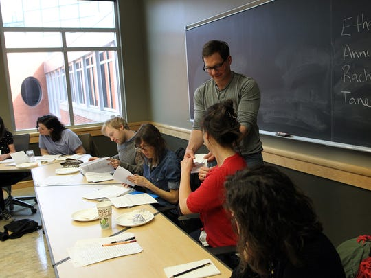 John D'Agata works with students in his course at the Adler Journalism Building on Monday, March 21, 2016.