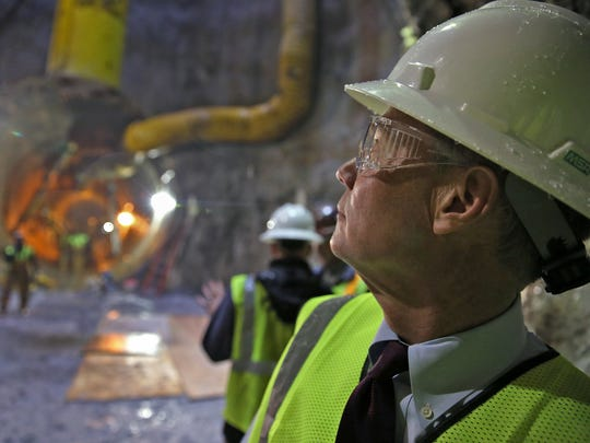 Mayor Joe Hogsett looks at a tunnel site in the DigIndy Tunnel System, Thursday, April 21, 2016.  A completion plan was announced at the site to complete the remaining 18 miles of tunnel.  The system is a 28-mile network of tunnels 250 feet underneath Indy designed to prevent sewage overflows from reaching area waterways during moderate rain events.