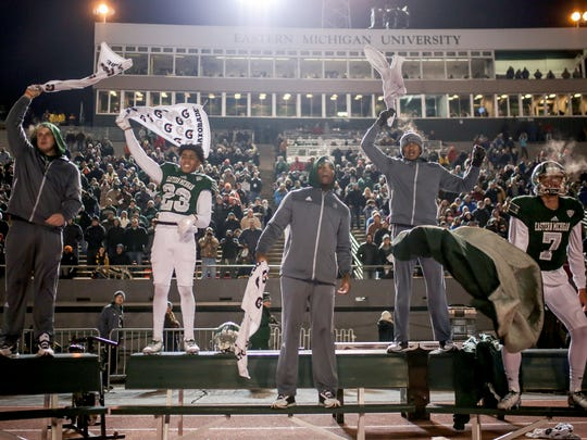 Eastern Michigan Eagles players on the bench cheer for their teammates during a game against Central Michigan Chippewas on Tuesday, November 22, 2016 at Rynearson Stadium in Ypsilanti.