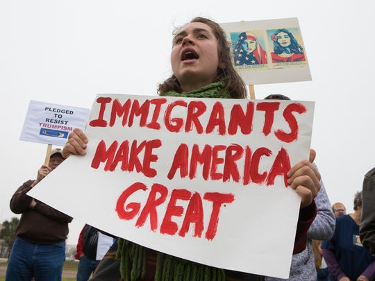 Anti-Trump protesters hold a rally outside the Federal Courthouse in Corpus Christi, Texas on Friday, Jan. 20, 2017.