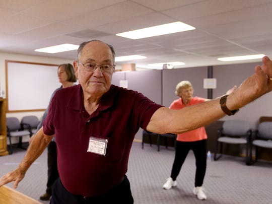 Earl McCollum of Sublimity, center, Betty McCollum of Sublimity, right, and Susan Braatz of Scio, move during a Tai Chi class at the Santiam Senior Center in Stayton on Friday, Sept. 18, 2015.