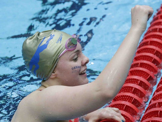 Carmel's Sammie Burchill raises her fist after competing