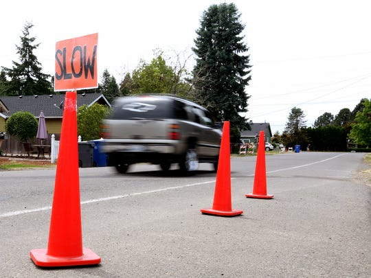 Traffic cones urge drivers to move slowly on a road near Scott Elementary School in Salem on Wednesday, June 7, 2017.
