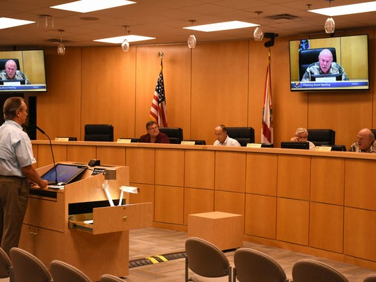 Public Works Director Tim Pinter spars with Marco Island Planning Board Vice-Chair Ed Issler about the proposed stormwater management ordinance. The board met Friday morning in the City Council chambers.