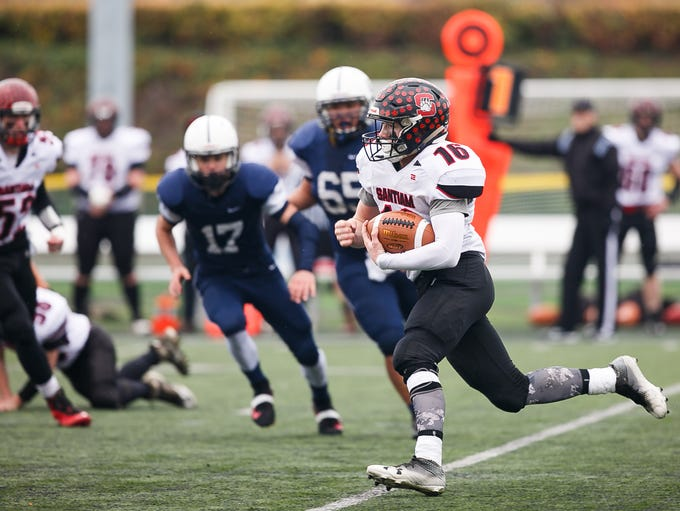 Santiam's Trevor Tinney (16) carries the ball in the