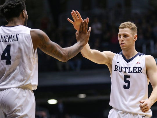 Butler Bulldogs forward Tyler Wideman (4) and Butler Bulldogs guard Paul Jorgensen (5) celebrate the team's lead during first half action between the Butler Bulldogs and the Princeton Tigers at Hinkle Fieldhouse, Indianapolis, Sunday, Nov. 12, 2017. Butler defeated Princeton, 85-75.