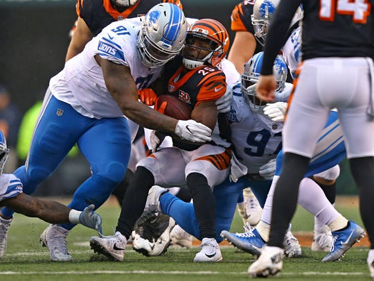 Lions defensive tackle A'Shawn Robinson (91) tackles Bengals running back Giovani Bernard (25) in the second half of the Lions' 26-17 loss on Sunday, Dec. 24, 2017, in Cincinnati.