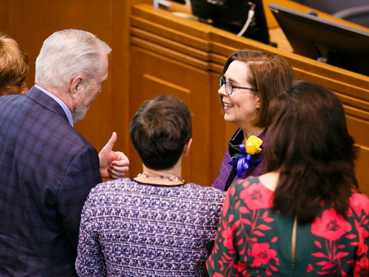 Senator Rod Monroe, D-Portland, gives a thumbs up to Gov. Kate Brown following her State of the State address on Monday, Feb. 5, 2018, at the Oregon State Capitol in Salem.