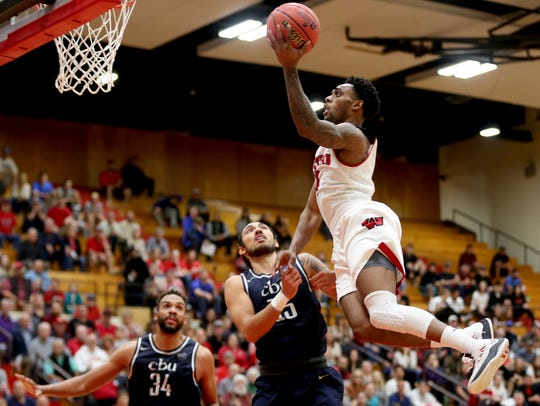 Western Oregon's Janvier Alaby (4) leaps for two points