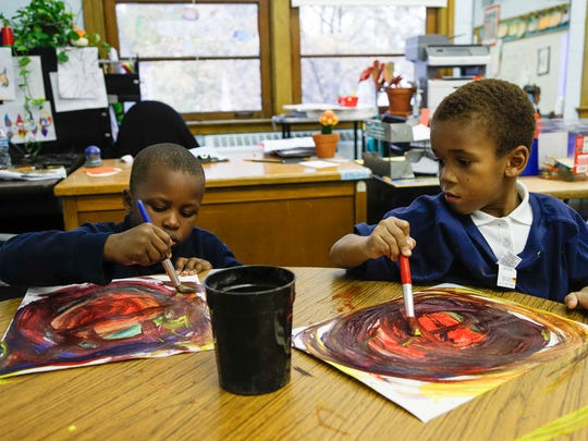 D'an Jones, left, and his classmate Damarzae Perkins Jackson, work on their work on their art class practice at the Mann Elementary School in Detroit, Thursday, November 9, 2017.